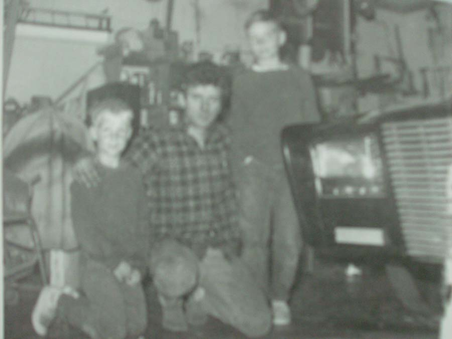 "Kid Dean (age 8) kneeling with Dean Jeffries and Green Hornet's ""Black Beauty"""